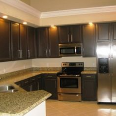 brown painted kitchen cabinets. Incridible Ceiling Kitchen Lighting Over Dark Brown Painted Cabinets And  Grey Granite Countertop With Diagonal Ceramic Tile Flooring Ideas In Contemporary Home