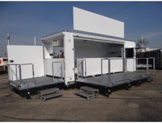 Custom 24' Mobile Trade Show Marketing Solution. This Custom Marketing Solution Features Two Roll Out Cabinets. Two Fold Out Stages, and Two Powered Awnings. Call for more information on this trailer. Ref # E202174 | Advantage Trailers and Hitches