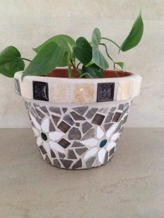 A personal favorite from my Etsy shop https://www.etsy.com/listing/230966584/handmade-mosaic-flower-pot-outdoor