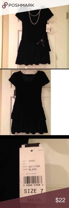 NWT Girl's party dress Beautiful black stretch velvety party dress for a girl (size 7). Never worn. Purchased from Macy's. Double strand of faux pearls are part of the dress. Dresses Formal
