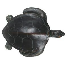 """Turtle statuette with a weathered finish.   Product: Turtle décorConstruction Material: ResinColor: Black and greenFeatures: Weathered finishDimensions: 6.5"""" H x 24"""" W x 19.5"""" D"""