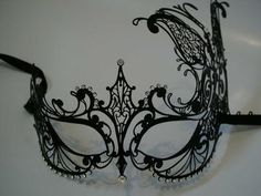 Black Venetian masquerade mask.... I have always wanted to host a masquerade.