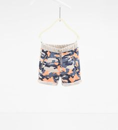Camouflage Bermuda shorts with zips