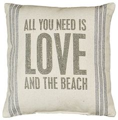 "- Decorative Beach House Throw / Accent Pillow with whimsical ""All You Need Is Love And The Beach"" print. - White Canvas Color Pillow with dark stone print and blue vertical pinstripes. - Linen exteri"