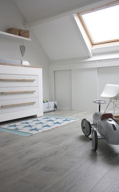 Loft conversion baby room - white with vintage car