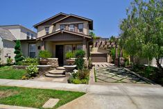 Craftsman style landscape and facade. Mid-tone Latte color stucco, Cafe trim, Chocolate accent (front door)