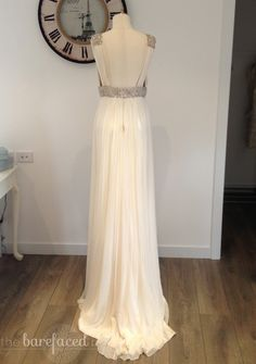 Grecian-inspired wedding dress by Helen English for Paddington Brides, made from delicate ivory silk georgette and featuring a silver embellished beaded bodice with v-neck. This sample designer wedding gown is available to try on at The Barefaced Bride studio.  Size: 10