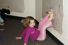 Drawing with your toes is fun and helps build core strength. All kids ages 3-8 are welcome at our YogaKids class at our Longmont early learning center. #kidsyoga #Longmont