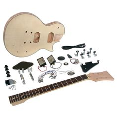Saga LP Style Electric Guitar Kit - Saga LC-ten LP Style Electric Guitar Kit Kit contains all components and directions to construct a comprehensive playable guitar. The physique is an arched best, single cutaway style made of select basswood wi Electric Guitar Kits, Cool Electric Guitars, Body Electric, Saga, Yamaha Acoustic Guitar, Fender Acoustic, Signature Guitar, Les Paul Guitars, Best Dad Gifts