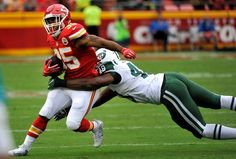 Kansas City Chiefs running back Charcandrick West is tackled by New York Jets linebacker Jordan Jenkins during the first half of an NFL game in Kansas City, Mo., Sunday, Sept. 25, 2016.