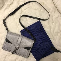 Rebecca Minkoff Mini Hudson Moto Crossbody Super cute Rebecca Minkoff crossbody! The gorgeous black and white embossed leather goes with everything and multiple compartments help keep you organized. Barely used with ZERO visible signs of wear. Includes duster bag. Rebecca Minkoff Bags Crossbody Bags