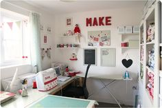 "although a small space it is laid out VERY well...with a U shaped work space it still allows space for the ironing board to stay set up!  I like the ""make"" on the wall, the cover for the sewing machine and the banners in the window all in red!"