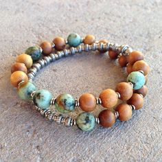 27 bead mala bracelet, made with sandalwood and African turquoise, hand made brass African Trade Beads (for sizing). It wraps as a bracelet, (stringed on thick hi-tec elastic). Cool unisex style! Sandalwood encompasses and enhances both the spiritual and physical well-being of men and women. It is thought that sandalwood guides away the distractions of the mind back to the sensual joy. African Turquoise, is a type of jasper that has the look of an earthy turquoise, it is said to bring…
