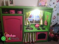 a homemade play kitchen from an old entertainment center! sooo cool and original!