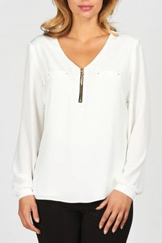 This pretty blouse from Frank Lyman features a soft draping and delicate gold details. This versatile top will pair great with your favorite work bottom, and a quick accessory swap will take you from day to night.   Gold Zippered Top by Frank Lyman. Clothing - Tops - Blouses & Shirts Clothing - Tops - Long Sleeve Illinois