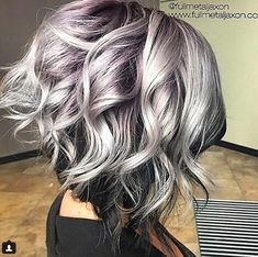 "This steely, smoky pastel silver with a deep purple shadow root is insane! We love it so much, we reached out to stylist Jackie Hovorka @fullmetaljaxon, a studio owner in Sioux Falls, S.D., to get the lowdown.   ""My client usually comes in wanting some pastel tones mixed with silvers, as it fades out nicely,"" … Continued"