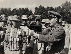 Chinese officer demonstrating the use of newly arrived American-made M3 submachine guns ('Grease Guns') to his men, late war | World War II Database