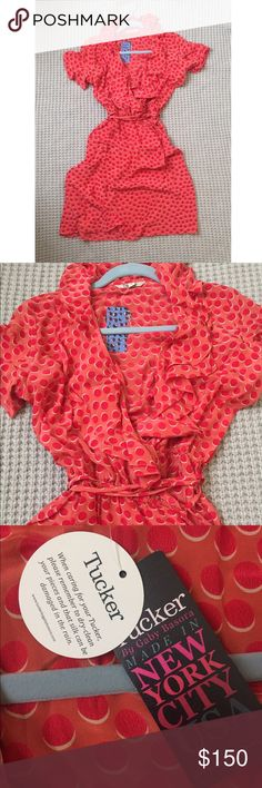 NWT Tucker Ruffle Wrap Dress Brand new ruffle wrap dress from tucker with fun polka dot print. Features hidden elasticized band at waist, ruffled collar and sleeves, and tie closure. 100% silk, made in NYC Tucker Dresses Midi