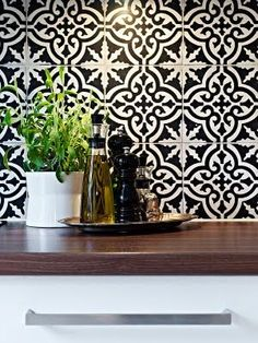 Tiles... Love a black and white kitchen with a pop color to accent. | Beautiful Places & Spaces t | Tile, White Kitchens and Black And White