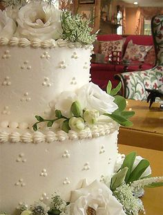 Swiss dot wedding cake design with fresh flowers for a wedding at The Ragamont House in Salisbury CT.