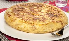 This is called Tortilla de patatas ( Potato omelet) which is one of the few plates eaten in all of Spain. It is made with eggs, potatoes and onions