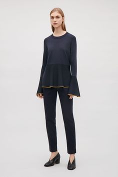 COS image 7 of Knitted peplum top with trims in Navy