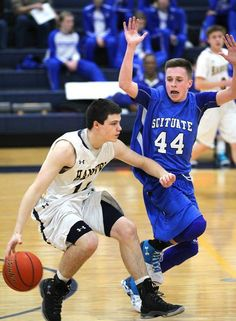Hanover's Andrew Carroll has his concentration distracted by Scituate defender Aidan Sullivan. Hanover High School boys' basketball beat Scituate High School 62-55 on Friday, Jan. 29, 2016. — Gary Higgins/The Patriot Ledger