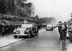 Adolf Hitler in an open car during the opening of the first section of Frankfurt / Main Heidelberg motorway near Darmstadt,1935