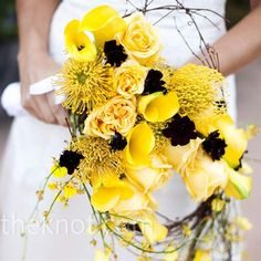 yellow calla lilies, roses, spider mums, and chocolate cosmos