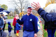 Upper Arlington residents and students bid heartfelt goodbyes last week to a retiring postman they said did much more than deliver mail for the past two decades.