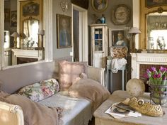 The cool, blue color palette and rustic stone walls make this living room perfectly serene and classic French country. Description from amycornwell.com. I searched for this on bing.com/images