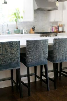 12 Ways to Upcycle Your Jeans: Ok yes, these slip-covered stools were likely made from cut denim by-the-yard, but the bleached pattern technique can work on upcycled jeans too. To get this look, use a bleach pen and stencils to create intricate patterns. Time consuming, yes, but a stunner for sure!