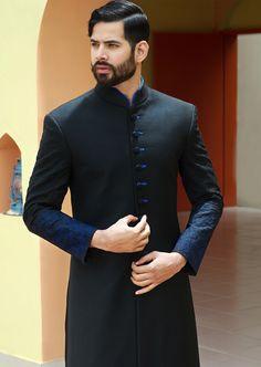 Black suiting straight cut. Amir Adnan