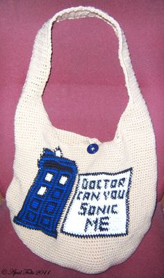 """Ravelry: Doctor Who Crochet Bag pattern by April Draven ( I'd use a different message; like """"Doctor Who bag: bigger on the inside"""" Doctor Who Crochet, Doctor Who Bags, Doctor Who Craft, Crochet Shell Stitch, Bead Crochet, Free Crochet, Kids Crochet, Crochet Flower, Irish Crochet"""
