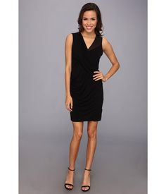 Elevate your look in this classy Vince Camuto® dress!. Sleeveless, sleek sheath dress with flatter...