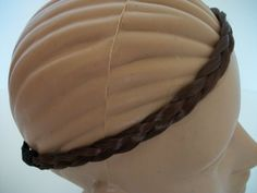 Braided hair headband hair headwrap (brown) by Silk Solutions. $4.99. elastic back stretch to fit. brown color as pictured. .5 inch width 9 inch length. synthetic hair. versatile. Check out our other colors, and hair accessories as well
