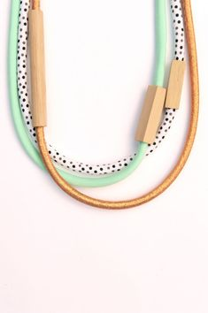 Handmade from unfinished Tasmanian oak hardwood and cotton fabric in peppermint, copper and black and white spots.  Total length of each necklace