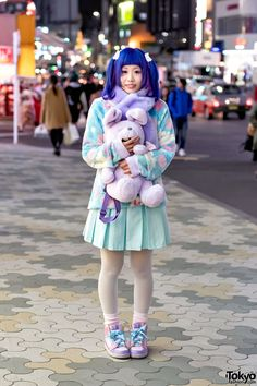 """ Honoka on the street in Harajuku with a blue purple twin tails hairstyle, a plush rabbit backpack from WC Harajuku, and fluffy pastel fashion from Swimmer, Milklim, and Angelic..."