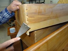 """Broken Drawer Corners:  The best fix starts with removing any nails from the corners. Then gently take the corner the rest of the way apart and sand away any remaining old glue. Apply wood glue, reassemble the corner and clamp the drawer until the glue dries. """"If the drawer is sticking, apply beeswax along the bottom rail to help it glide,"""" she says"""