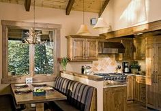 Rustic cabin kitchen! love the seating arrangement