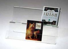 ClearDisplays.com offers this counter display with two tiers which we also use to display board books inside bookcases ... you maximize the space between shelves with more face-outs.