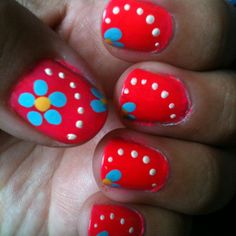 Pink nails with blue flowers and white dots. Not done by me, done by @Robin Wakeman on my nails.