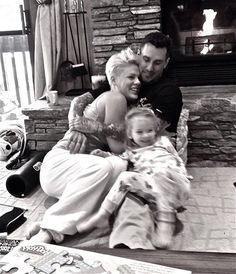 Pink New Year's Eve Photo: Singer's Family Pic Of Carey Hart, Willow - Us Weekly....One of the cutest families ever.