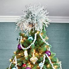 #Sparkly_Topper - Don't let the look get too serious! To make your own #tree_topper, bundle together a group of curly silver sticks, and wire it to the top of the tree.