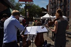 A string quartet entertains the crowds at Brunel Square Market.