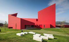 Future Architecture Thinking designs the flame-red House of the Arts in Miranda do Corvo