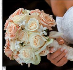 """Soft, neutral colors infused their wedding day, along with a classic choice for blooms: roses. """"The whole theme of the wedding somehow revolved around roses -- the colors, the design of roses on the alençon lace [on her wedding gown] -- and they were the only flowers I used throughout the entire wedding,"""" Hannah says  from the album: Hannah & Samuel: A Formal Wedding in Wilmington, DE"""