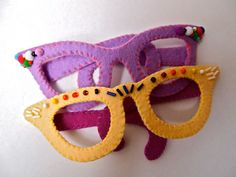 Fake Glasses, cream felt Mad Men cats eyes, beaded role play, dress up face mask. £15.75, via Etsy.