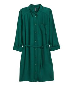 Emerald green. Short shirt dress in woven fabric. Collar, buttons at front, chest pockets with button, and long sleeves. Tie at waist.