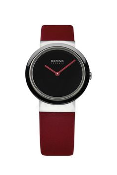 This beautiful high-tech ceramic watch is scratch-resistant, ultra-lightweight with hypoallergenic material and a smooth-touch surface. It is protected against the rain, however it must not be submerged under water. This watch has an extended, international three-year warranty. Product details: Strap color is red, case color is shiny silver, strap material is calfskin, case material is stainless steel, bezel material is ceramic, bezel color is black, dial color is black, movement type is…